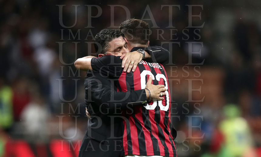 Calcio, Serie A: AC Milan - AS Roma, Milano stadio Giuseppe Meazza (San Siro) 31 agosto 2018. <br /> AC Milan's coach Gennaro Gattuso (l) celebrates with his player Patrick Cutrone (r) after winning 2-1 the Italian Serie A football match between Milan and Roma at Giuseppe Meazza stadium, August 31, 2018. <br /> UPDATE IMAGES PRESS/Isabella Bonotto