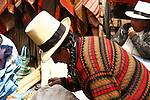 A Peruvian vendor at the Pisac market wearing an unique hat.