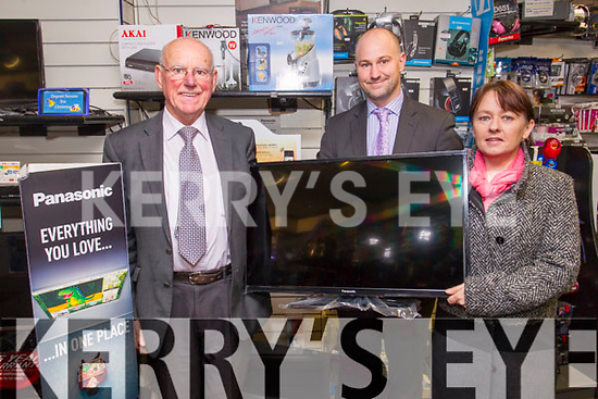 """Hugh Culloty and Brendan Culloty pictured Patricia Moynihan, Tralee, who is the winner of the Christmas Club draw Panasonic 32"""" Colour Television at Hugh Cullotys, The Mall Tralee on Tuesday morning."""