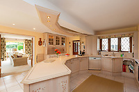 BNPS.co.uk (01202 558833)<br /> Pic: Savills/BNPS<br /> <br /> Pictured: The open kitchen looking through to the living room.<br /> <br /> A historic thatched home where Cromwell's army stayed during the English Civil War is on the market for £1.6m.<br /> <br /> The Barracks, so-named for its links with Cromwell more than 370 years ago, has spectacular country views and is in one of Cheshire's most popular areas.<br /> <br /> The five-bedroom property just outside the picturesque village of Bunbury is a far cry from how it would have looked in Cromwell's time, having been extended over the years.<br /> <br /> It was used in the 17th century by Cromwell's armies during the siege of Beeston Castle - two miles away. The castle's location made it valuable to both the royalists and parliamentarians.