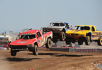 Apr 17, 2011; Surprise, AZ USA; LOORRS driver John Harrah (13) leads Jerry Daugherty and Travis Coyne (5) during round 4 at Speedworld Off Road Park. Mandatory Credit: Mark J. Rebilas-