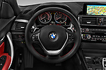 Car pictures of steering wheel view of a 2015 BMW 2 Series  Sport 2 Door Convertible