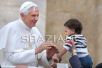 Pope Benedict XVI waves as he leaves his weekly general audience on May 26, 2010 at St Peter's square at The Vatican.