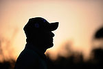 TAIPEI, TAIWAN - NOVEMBER 20:  Lu Chien Soon of Taiwan silhouetted against the sunset sky on the 18th hole during day three of the Fubon Senior Open at Miramar Golf & Country Club on November 20, 2011 in Taipei, Taiwan.  Photo by Victor Fraile / The Power of Sport Images