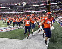 ATLANTA, GA - DECEMBER 31: The Virginia Cavaliers walk off the field before the 2011 Chick Fil-A Bowl against the Auburn Tigers at the Georgia Dome on December 31, 2011 in Atlanta, Georgia. Auburn defeated Virginia 43-24. (Photo by Andrew Shurtleff/Getty Images) *** Local Caption ***