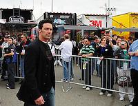 Feb 22, 2009; Fontana, CA, USA; Former football player Jason Sehorn tours the garage prior to the Auto Club 500 at Auto Club Speedway. Mandatory Credit: Mark J. Rebilas-