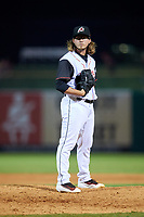 Arkansas Travelers relief pitcher Zac Curtis (16) looks in for the sign during a game against the Frisco RoughRiders on May 26, 2017 at Dickey-Stephens Park in Little Rock, Arkansas.  Arkansas defeated Frisco 4-2.  (Mike Janes/Four Seam Images)