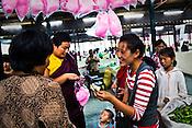 Local Bhutanese buy candy floss in a local market in Thimphu, Bhutan. Photo: Sanjit Das/Panos