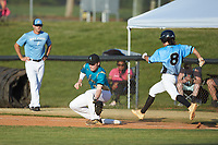 Mooresville Spinners first baseman Tanner Burns (9) (Limestone College) stretches for a low throw as Carson Phunteck (8) (Langtree Charter HS) of the Dry Pond Blue Sox hustles down the line at Moor Park on July 2, 2020 in Mooresville, NC.  The Spinners defeated the Blue Sox 9-4. (Brian Westerholt/Four Seam Images)