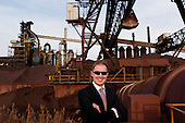 "Dearborn, Michigan<br /> USA<br /> February 16, 2011<br /> <br /> Sergei A. Kuznetsov, chief executive officer of Severstal North America in front of the old (left) and new ""C"" blast furnaces. <br /> <br /> The former Ford Rouge Steel Plant completed in 1928 is now owned, run and being renovated and expanded by Russian owner ""Severstal North America"". This is one of five steel plants owned by Severstal in the United States and they are spending huge sums to convert it into what could be the continent's most efficient automotive steel plant.<br /> <br /> Rouge Steel fell on hard times after Ford Motor Company spun it off in 1989 into an independent steel company. <br /> <br /> After buying the assets of the bankrupt company for USD 280 million, Severstal spent USD 350 million to repair one of the blast furnaces. The company built a new cold-rolling line which converts steel slabs into sheet metal. And it added a galvanizing line which coats sheet metal with zinc for rust-resistant body panels.<br /> <br /> The operation assets and improvements amount to USD 1.4 billion. Add in spending on a new mini mill in Columbus, Mississippi a USD 1.6 billion operation and Severstal has placed a USD 3 billion bet on North America auto industry.<br /> <br /> Mr Kuznetsov said ""The auto industry will have to meet tough fuel efficiency standards and weight is a big issue. Vehicles have to be lighter and I think this is going to be a big play for the industry."""