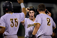Bradenton Marauders Jackson Glenn (10) celebrates with Jase Bowen (2) and Maikol Escotto (35) after hitting a home run during Game Three of the Low-A Southeast Championship Series against the Tampa Tarpons on September 24, 2021 at George M. Steinbrenner Field in Tampa, Florida.  (Mike Janes/Four Seam Images)