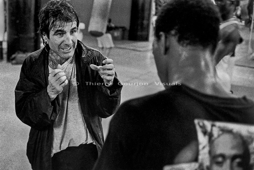 Former professional fighter Domenic Monaco discussing technique with a young fighter at Gleason's Gym, Brooklyn, New York.<br />Photograph by Thierry Gourjon-Bieltvedt. 1995-2005