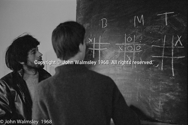 """Playing """"Noughts & Crosses"""" with the Science teacher, Summerhill school, Leiston, Suffolk, UK. 1968."""