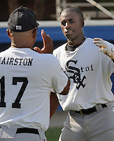 July 22, 2009: Batting coach Jerry Hairston (17) of the Bristol White Sox, rookie Appalachian League affiliate of the Chicago White Sox, instructs infielder Kyle Davis (1) prior to a game at Burlington Athletic Stadium in Burlington, N.C. Photo by:  Tom Priddy/Four Seam Images