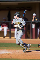 Brennan Morgan (21) of the Kennesaw State Owls follows through on his swing against the Winthrop Eagles at the Winthrop Ballpark on March 15, 2015 in Rock Hill, South Carolina.  The Eagles defeated the Owls 11-4.  (Brian Westerholt/Four Seam Images)