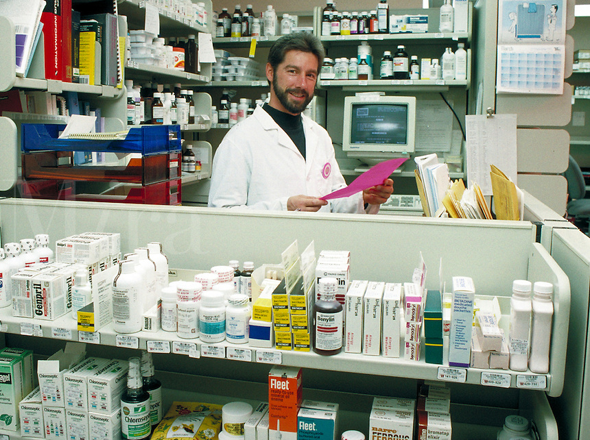 Pharmacist at work in pharmacy.