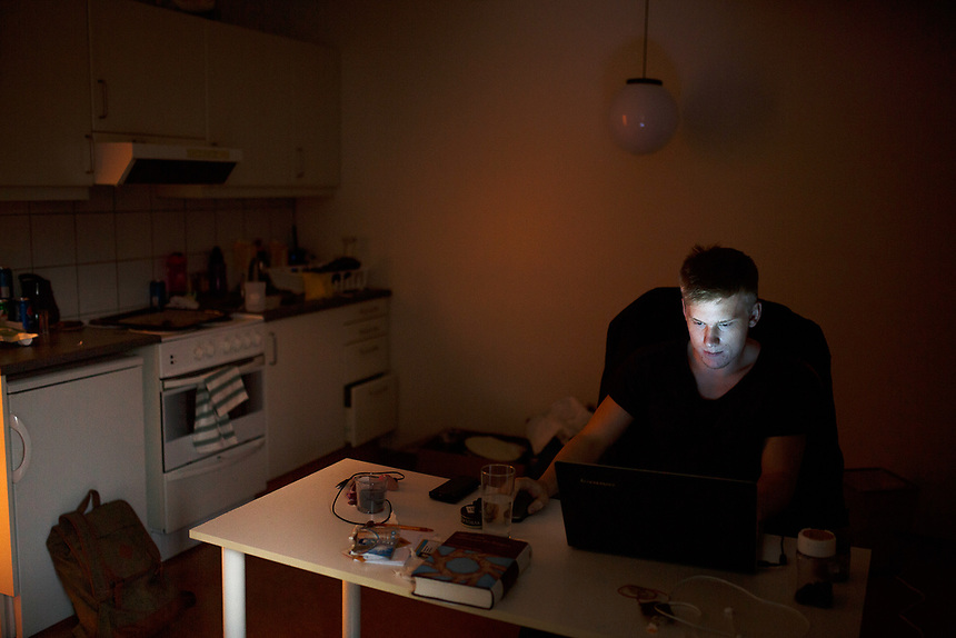 A series of portraits of people playing video games
