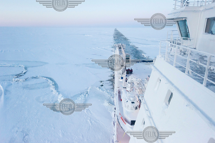 The ice breaking and supply ship 'Fedor Ushakov' forces a passage through the sea ice as the vessel makes a voyage along the Northern Sea Route.