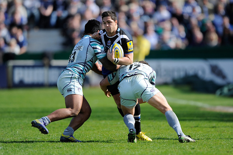 Horacio Agulla of Bath Rugby is tackled by Manusamoa Tuilagi (left) and Anthony Allen of Leicester Tigersduring the Aviva Premiership match between Bath Rugby and Leicester Tigers at The Recreation Ground on Saturday 20th April 2013 (Photo by Rob Munro)