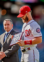 26 September 2018: Washington Nationals outfielder Bryce Harper receives the Player of the Year Award presented by MASN Reporter Mark Zuckerman prior to a game against the Miami Marlins at Nationals Park in Washington, DC. The Nationals defeated the visiting Marlins 9-3, closing out Washington's 2018 home season. Mandatory Credit: Ed Wolfstein Photo *** RAW (NEF) Image File Available ***