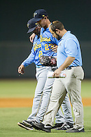 Myrtle Beach Pelicans relief pitcher Cody Kendall (23) is helped off the field by trainer Jacob Newburn and manager Joe Mikulik during the game against the Winston-Salem Dash at BB&T Ballpark on July 16, 2014 in Winston-Salem, North Carolina.  The Pelicans defeated the Dash 6-2.   (Brian Westerholt/Four Seam Images)