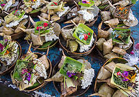Bali, Indonesia.  Offering Baskets (Canang) Made in Hopes of a Bountiful Rice Harvest.  Pura Dalem Temple, Dlod Blungbang Village.