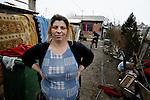 """THIS PHOTO IS AVAILABLE AS A PRINT OR FOR PERSONAL USE. CLICK ON """"ADD TO CART"""" TO SEE PRICING OPTIONS.   Giltena Duda in front of her home in the Zemun Polje Roma neighborhood of Belgrade, Serbia. Ms. Duda is pregnant with her seventh child. She and her husband are Roma refugees from Kosovo, and thus legally marginalized in Serbia. They built their home on unregistered land and pirate their electrical hookup. Without legal residency, their children can't attend a regular school, and they have difficulties getting formal employment. Yet both participate in an adult literacy program sponsored by the Branko Pesic School, where their children attend classes. The school is supported by Church World Service."""