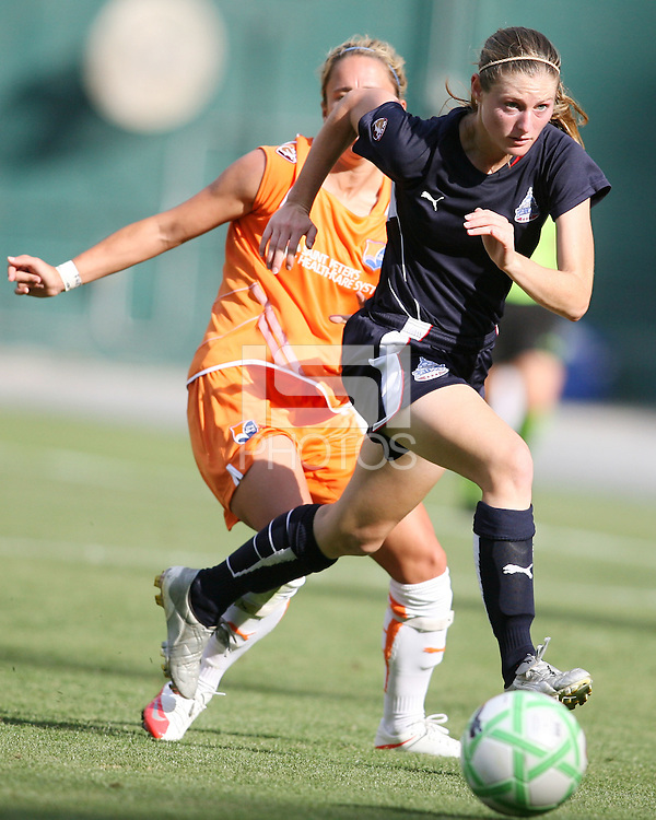 Jill Gilbeau #3 of Washington Freedom gets past Kacey White #20 of Sky Blue FC during a WPS match at RFK Stadium on May 23, 2009 in Washington D.C. Freedom won the match 2-1