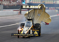 Feb 8, 2014; Pomona, CA, USA; NHRA top fuel dragster driver Tony Schumacher during qualifying for the Winternationals at Auto Club Raceway at Pomona. Mandatory Credit: Mark J. Rebilas-