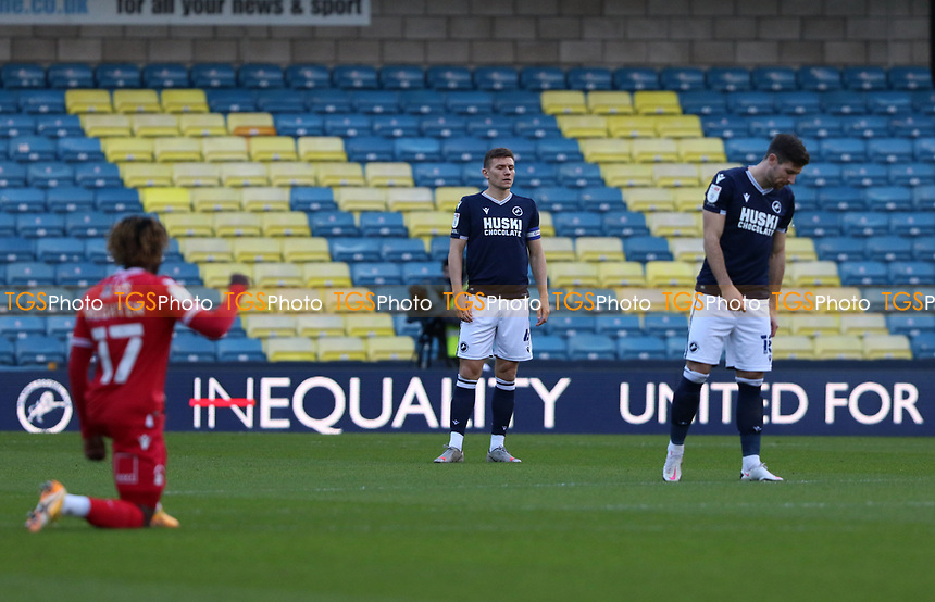 Millwall players stand as Alex Mighten of Nottingham Forest kneels during Millwall vs Nottingham Forest, Sky Bet EFL Championship Football at The Den on 19th December 2020