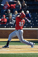 Chandler Redmond (35) of the Gardner-Webb Runnin' Bulldogs follows through on his swing against the Wake Forest Demon Deacons at David F. Couch Ballpark on February 18, 2018 in  Winston-Salem, North Carolina. The Demon Deacons defeated the Runnin' Bulldogs 8-4 in game one of a double-header.  (Brian Westerholt/Four Seam Images)