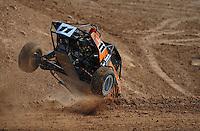 Mar. 19, 2011; Chandler, AZ, USA;  LOORRS pro buggy unlimited driver Bobby Pecoy crashes during round one at Firebird International Raceway. Mandatory Credit: Mark J. Rebilas-