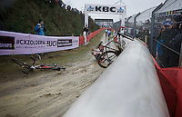 Kevin Kuhn (SUI) crashes with Mitch Groot (NLD) on the muddy descent<br /> <br /> Junior Men's race<br /> UCI 2016 cyclocross World Championships