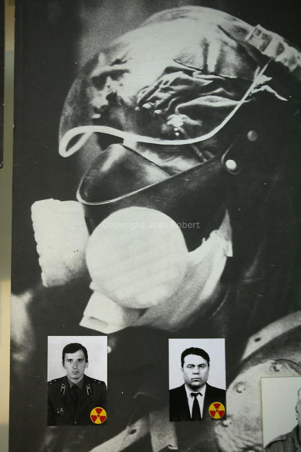 Chernobyl  Museum in  Kiev, Ukrainia..Dedicated to the liquidators and victims of the explosion of the Chernobyl reactor. photo collage of liquidators. The red and yellow radioactive symbol indicates the ones who died.Musée de Tchernobyl, Kiev, Ukraine..Dédiés aux liquidateurs et victimes de l'explosion, du réacteur de Tchernobyl. collage de photos de liquidateurs. Le sigle rouge et jaune radioactif indique les personnes décédées