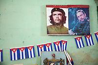 Cuba, Havana.  Leaders of the Revolution, Che Guevara and Fidel Castro.  Wall Decoration inside a Store.