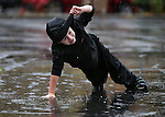 Caden McGarvey, 5, plays in the rain during the Road to the Future celebration in downtown Carson City, Nev. on Friday, Oct. 28, 2016. <br /> Photo by Cathleen Allison