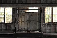Light seeps under the doors at the Kennicott Mine power plant.