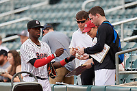 Birmingham Barons Luis Robert (26) signs autographs before a Southern League game against the Chattanooga Lookouts on May 1, 2019 at Regions Field in Birmingham, Alabama.  Chattanooga defeated Birmingham 5-0.  (Mike Janes/Four Seam Images)