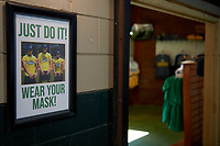 A sign in the stadium walkway as you enter the team store to remind fans to wear a mask before a Collegiate Summer League game  between the Macon Bacon and Savannah Bananas on July 15, 2020 at Grayson Stadium in Savannah, Georgia.  (Mike Janes/Four Seam Images)