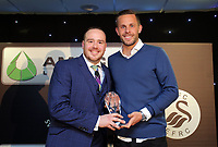 Pictured: Gylfi Sigurdsson (R) receives an award  Wednesday 18 May 2017<br /> Re: Swansea City FC, Player of the Year Awards at the Liberty Stadium, Wales, UK.