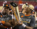 Clemson quarterback Deshaun Watson admires the National Championship trophy after defeating Alabama to win the 2017 College Football Playoff National Championship in Tampa, Florida on January 9, 2017.  Clemson defeated Alabama 35-31. Photo by Mark Wallheiser/UPI