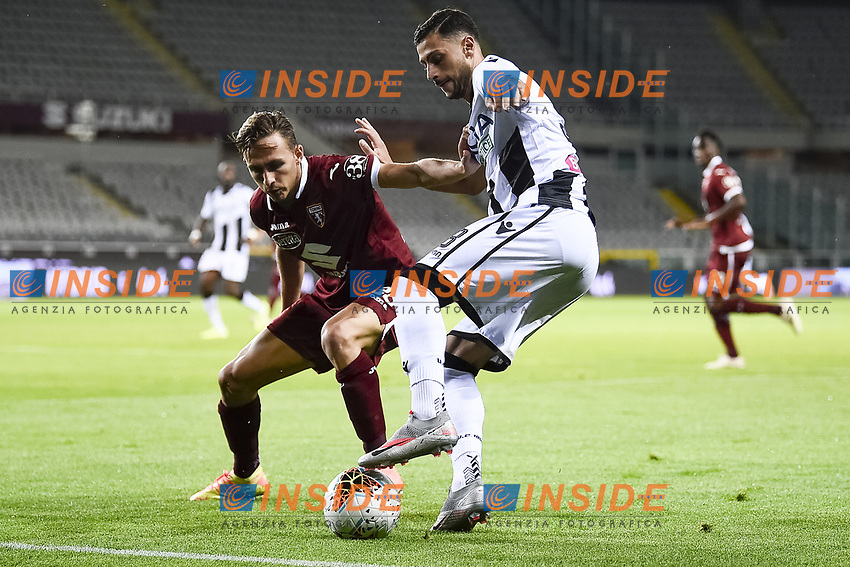 Simone Edera of Torino FC and Rolando Mandragora of Udinese Calcio compete for the ball during the Serie A football match between Torino FC and Udinese at Olimpico stadium in Torino ( Italy ), June 23th, 2020. Play resumes behind closed doors following the outbreak of the coronavirus disease. <br /> Photo Image Sport / Insidefoto