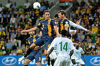 Lucas NEILL (2) and Mark MILLIGAN (8) of Australia jump for the ball during the FIFA 2014 World Cup Group D Asian Qualifier match between Australia and Saudi Arabia at AAMI Park in Melbourne, Australia...This image is not for sale on this web site. Please contact Southcreek Global Media for licensing:.Toll Free: 1.800.934.5030.Canada: 701 Rossland Rd. East, Suite 315, Whitby, Ontario, Canada, L1N 9K3.USA: 10792 Baron Dr, Parma OH, USA 44130.Web: http://southcreekglobal.net/ and http://southcreekglobal.com/