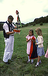 Morris dancers Whitchurch. Ritual of a sword placed through a Plum Cake, small distribution to local children following the team around with their parents. Buckinghamshire  England  1990s.