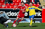 Aberdeen v St Johnstone....19.02.12   SPL.Jason Brown dives at the feet of Chris Millar to deny him.Picture by Graeme Hart..Copyright Perthshire Picture Agency.Tel: 01738 623350  Mobile: 07990 594431