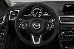 Car pictures of steering wheel view of a 2018 Mazda Mazda3 Grand-Touring 5 Door Hatchback Steering Wheel