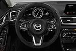 Car pictures of steering wheel view of a 2018 Mazda Mazda3 Grand-Touring 5 Door Hatchback Steering Wheel