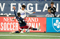 FOXBOROUGH, MA - OCTOBER 16: Nicolas Firmino #29 of New England Revolution II reaches to block a pass from Justin Che #46 of North Texas SC during a game between North Texas SC and New England Revolution II at Gillette Stadium on October 16, 2020 in Foxborough, Massachusetts.