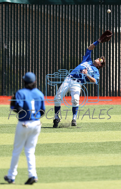 Western Nevada's Matt Becker tries to catch a fly ball in left field during a college baseball game  against College of Southern Nevada in Carson City, Nev., on Friday, March 22, 2013. The Wildcats won the opener 4-1. .Photo by Cathleen Allison/Nevada Photo Source