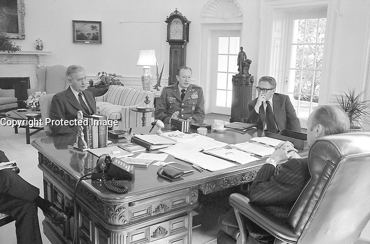President Ford Meeting with Secretary of State Henry Kissinger, Army Chief of Staff General Frederick Weyand, and Graham Martin, Ambassador to Vietnam, in the Oval Office.  25 March 1975